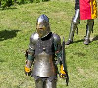 Knight in armor in nature. Stock Photos