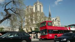 Traffic passes notre dame cathedral, paris, france Stock Footage