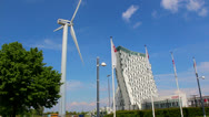 Stock Video Footage of Wind turbine outside hotel