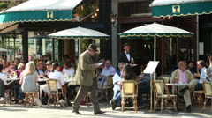 People sit at paris cafe on a sunny spring day, france Stock Footage