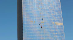 Timelapse of three urban alpinists are on steel and glass facade Stock Footage