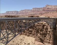 Traffic on Navajo Steel Arch Highway Bridge crossing Colorado river Stock Footage