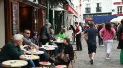 People sit at pavement cafe in place du tertre, paris Stock Footage
