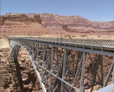 Navajo Steel Arch Highway Bridge pan from first to second bridge Stock Footage