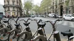 Velib cycle stand on boulevard haussmann, paris Stock Footage