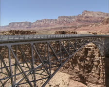 Marble Canyon Steel Arch Highway Bridge pan from new bridge to original Stock Footage