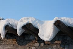 wooden roof, drooping snow 4 - stock photo