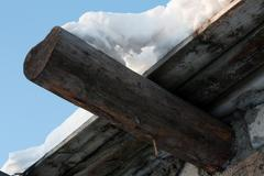 wooden roof, drooping snow 2 - stock photo