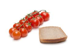 red tomatoes cherry, pumpernickel two - stock photo
