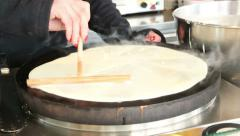 woman making a crepe pancake, paris, france - stock footage