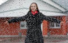beautiful girl with red scarf and umbrella - stock photo