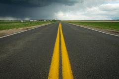Yellow Stripe Highway with Storm Stock Photos