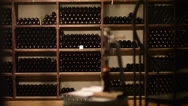 Stock Video Footage of Wine bottles on a shelf - dolly shot
