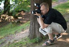 man with photocamera - stock photo