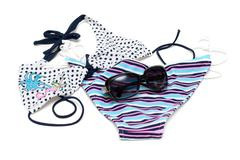 Sunglasses to rest upon swimsuit Stock Photos