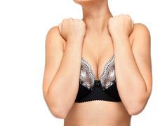 younger girl keeps itself for bosom - stock photo