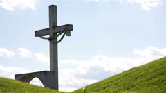 Cross behind green hills Stock Footage