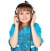 Girl in earphone smiles, portrait Stock Photos