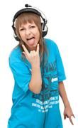 Girl in earphone shows language Stock Photos
