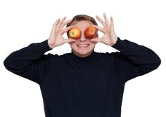 man with apple on eye - stock photo