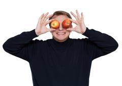 Man with apple on eye Stock Photos