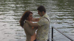 Romantic young couple near water Stock Footage