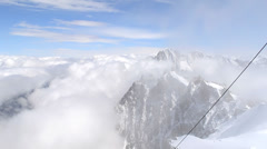 Climbers going down snow ridge Stock Footage