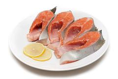 red fish bit with lemon on plate - stock photo
