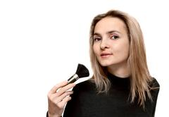 Portrait beautiful girl with make-up brush Stock Photos