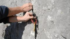 Placing climbing protection Stock Footage