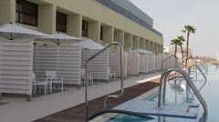 Swimming pool near beach hotel Stock Footage
