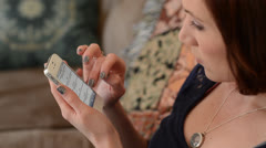Woman uses smart phone - stock footage