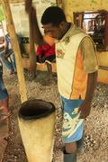 Local man processing cocoa beans in small village factory, samana peninsula Stock Photos