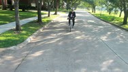 Stock Video Footage of green concept businessman on bike riding home