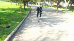 Green concept businessman on bike riding to work Stock Footage