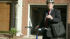 Green concept businessman taking bike to work Stock Footage
