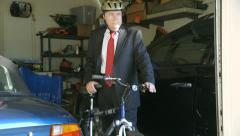 Green concept businessman taking bike out of garage Stock Footage