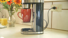 Green concept wide shot unplugging coffee maker Stock Footage