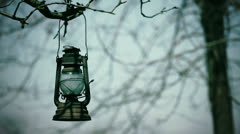 Old lantern hanging on the tree Stock Footage