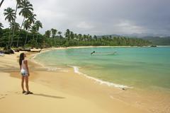 Young woman standing at rincon beach, samana peninsula Stock Photos