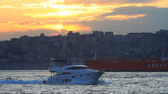 Cruise yacht and tanker ship cruising into Bosporus Stock Footage