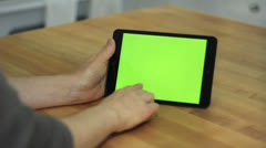 Woman Using Horizontal Tablet on Table - Various Hand Gestures - Green Screen Stock Footage