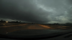 HD Stock Footage -  Driving in storm, small country town, sunset HD1080p Stock Footage