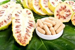 noni fruits (morinda citrifolia) - stock photo