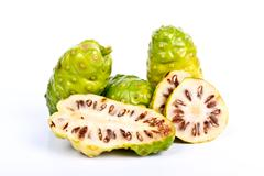 noni fruits (morinda citrifolia) - stock photo