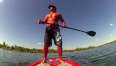 SUP FIT GUY POINT OF VIEW STAND UP PADDLE BOARDING RIVER LAKE HD 1080 CLIP Stock Footage