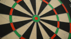 Dart board close up, centered bullseye Stock Footage