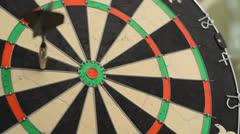 Dart board close up, left of center bullseye Stock Footage