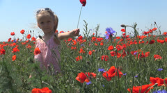 Smiling Girl Playing with Poppy Flower on Field, Child on a Meadow, Children Stock Footage