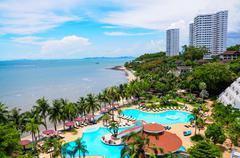swimming pools and bar at the beach of luxury hotel, pattaya, - stock photo